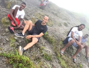 Minister carries wheelchair bound youth to top of La Soufriere