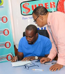 Super 6 half a million dollar winner collects his prize