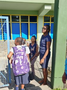 Teachers volunteer to do temperature checks