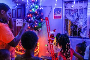 Samuel flips the switch on his Christmas lights